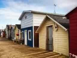 boat houses along canandaigua lake on wooden dock